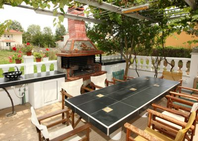Nereids apartments and studios common space with barbecue, refrigerator, big table etc.